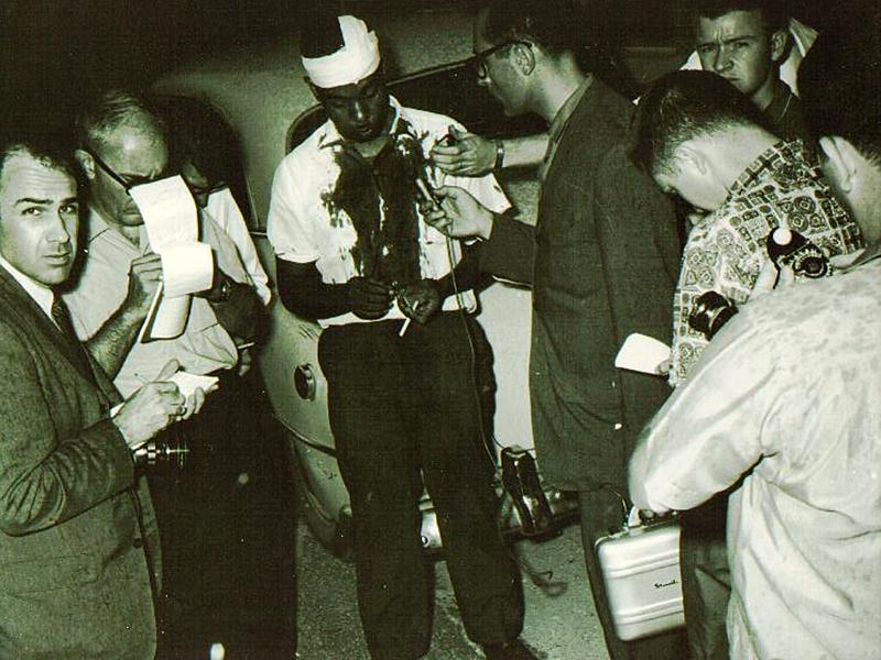 An injured C.B. King talks to reporters after being caned by Dougherty County sheriff Cull Campbell in the sheriff's office