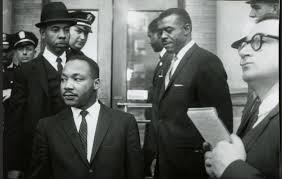 C.B. King (wearing hat) working with Martin Luther King Jr.