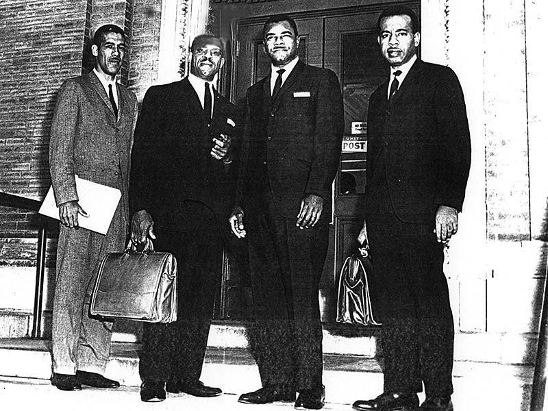 (Left to right) Attorney T. M. Jackson, chief counsel Donald Hollowell, Dr. William G. Anderson, and attorney CB King stand in front of the Albany federal courthouse and post office