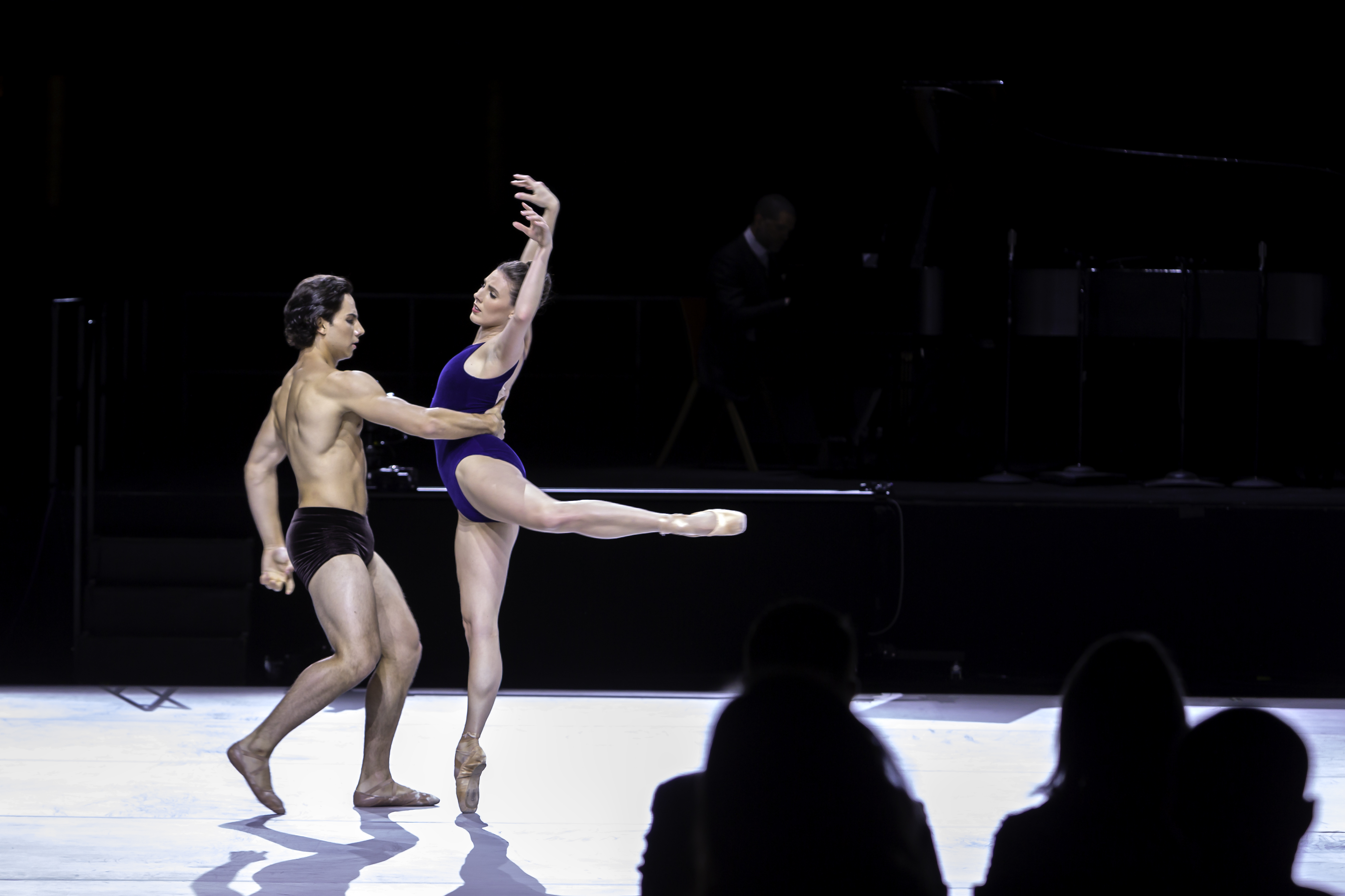 """Roman Mejia and Tiler Peck performing Alonzo King's Swift Arrow on stage at the Opera House during """"An Evening of Jazz and Dance"""" at The Kennedy Center."""